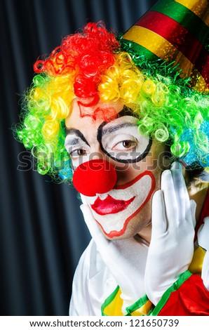 Funny clown in studio shooting - stock photo