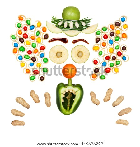 Funny clown made of vegetables and fruits in a kids menu isolated on white.