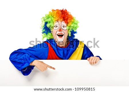 Funny clown standing over a white background and pointing - stock photo