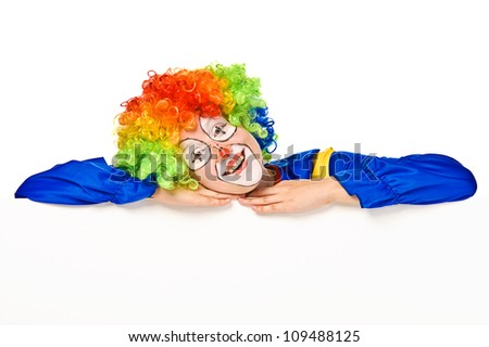 Funny clown standing over a white background and smiling - stock photo