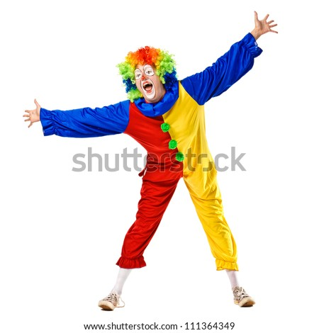 Funny clown standing over a white background. Isolated - stock photo
