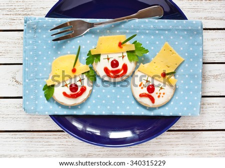 Funny clown two cheese crackers for children breakfast.