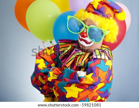 Funny clown with oversize glasses making a gangsta pose. - stock photo