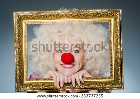 Funny clown with picture frame - stock photo