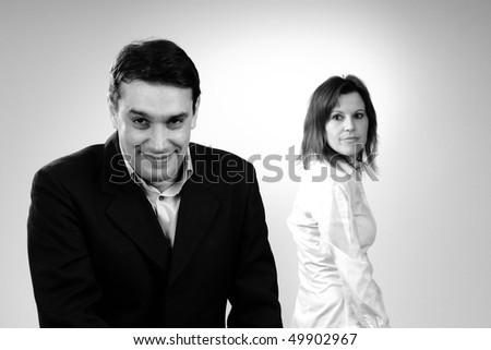 funny colleague and upset woman - stock photo