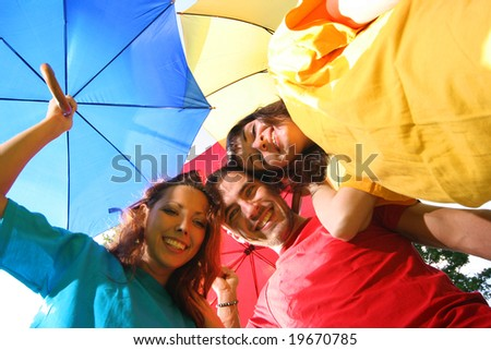 funny colorful friends with umbrellas