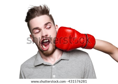 Funny concept for man with windblown mouth. Somebody beating man with boxing gloves. Isolated on white background