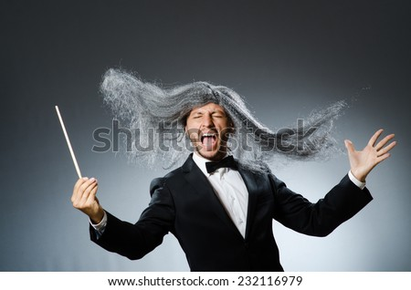 Funny conductor with long grey hair - stock photo