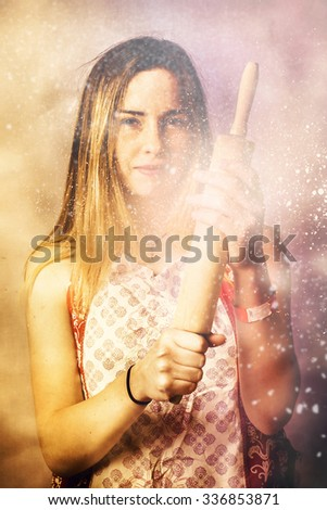 Funny cooking portrait of a baking girl whipping up kitchen treat in a mad rush of abstract flour. Quick bake pinup girl - stock photo