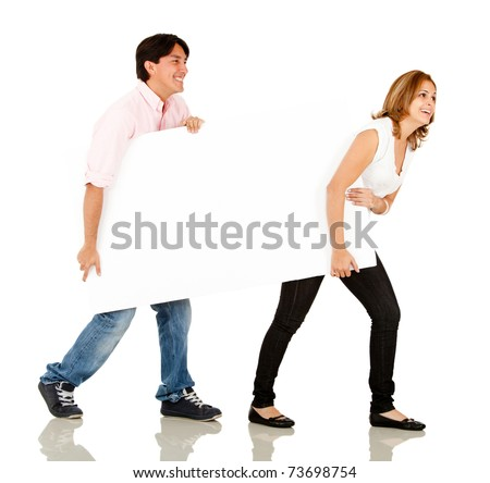 Funny couple carrying a banner - isolated over a white background - stock photo