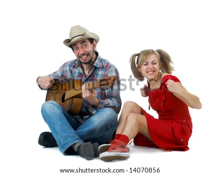 funny couple in western style with guitar on white background - stock photo
