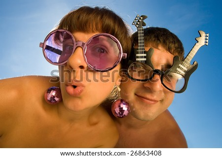 funny couple is making faces with smile - stock photo