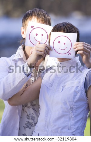 funny couple showing sign of smiley - stock photo
