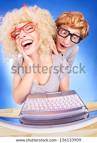 Funny couple using  laptop computer - stock photo