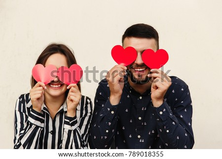 Funny Couple With Red Heart At Valentines Day. Romantic Emotion At First  Date. Love