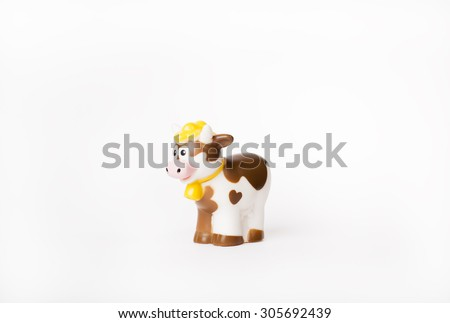 Funny cow toy isolated - stock photo