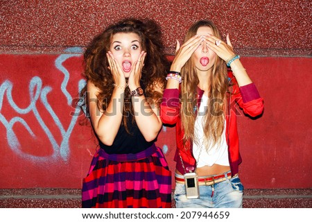 Funny crazy emotional pretty girls having fun and surprised ofter night party together on the street background in city  - stock photo