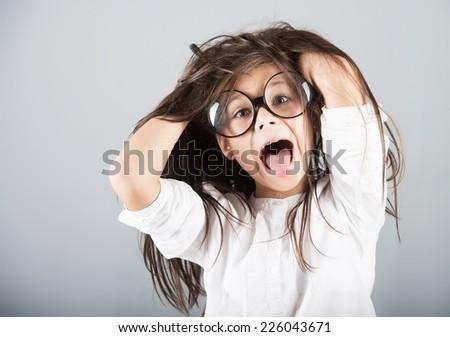 Funny crazy girl, studio shot, gray background - stock photo