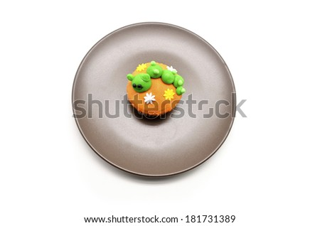funny cupcake with caterpillar - stock photo
