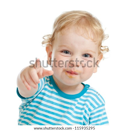 funny curly child with dirty lips pointing by finger directly to camera - stock photo