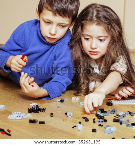 funny cute children playing  at home, boys and girl smiling, first education role close up - stock photo