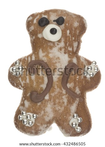 funny cute delicious gingerbread teddy bear pattern and decorated with silver sugar balls isolated on white background - stock photo