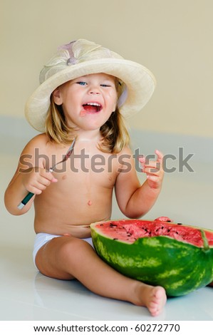funny cute girl in hat eating with appetite ripe watermelon