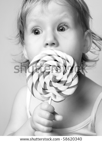 funny cute girl with lollipop - stock photo