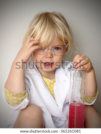 Funny cute little girl playing chemistry. Science concept. - stock photo