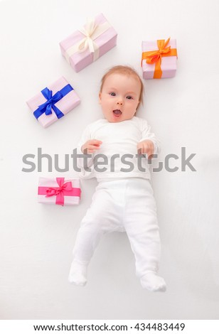 funny cute little newborn with presents - stock photo