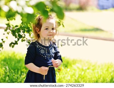 funny cute toddler girl in spring day - stock photo