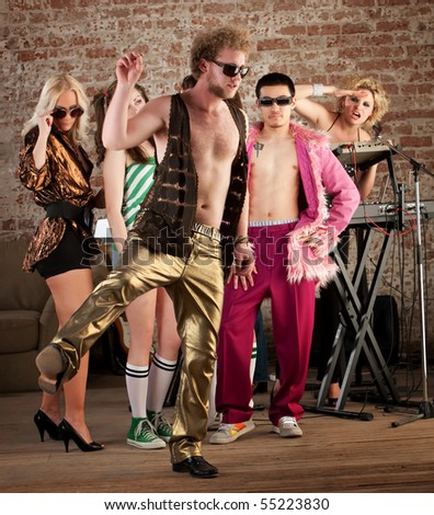 Funny dancing at a 1970s Disco Music Party - stock photo