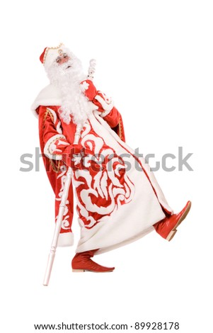 Funny Ded Moroz (Father Frost) with a stick - stock photo