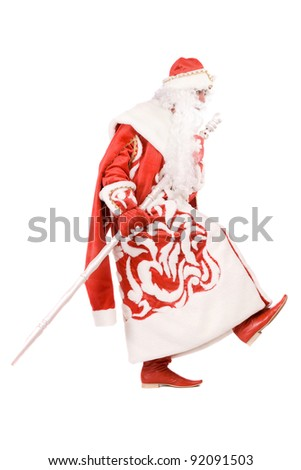 Funny Ded Moroz (Father Frost) with a stick. Isolated - stock photo