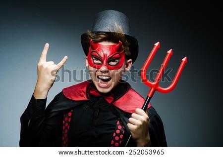Funny devil against dark background - stock photo