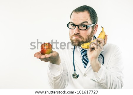 Funny doctor with fruit, apple and banana, serious about healthy nutrition