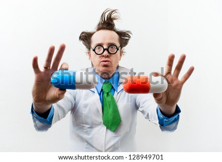 Funny doctor with pills in hand - stock photo
