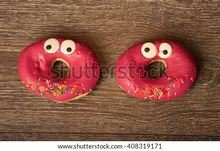 funny donut on wooden table - stock photo