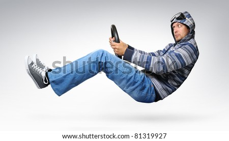 Funny driver with wheel in a jacket with a hood, concept - stock photo