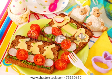 funny easter breakfast with bunny and chicken shape on sandwich for child