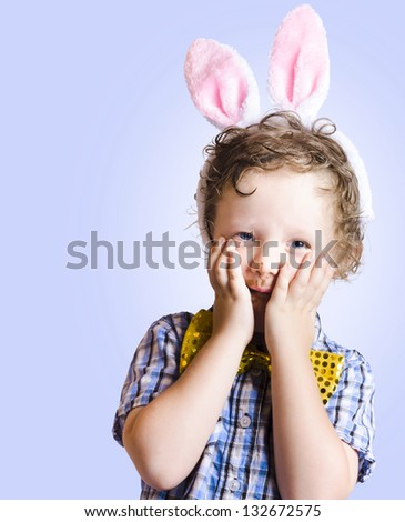 Funny Easter Kid Looking Shocked With Hands To Face In A Surprise Easter Concept - stock photo