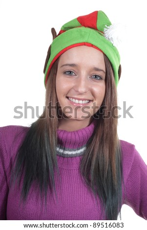 Funny Elf hat worn by a young teenage girl - stock photo