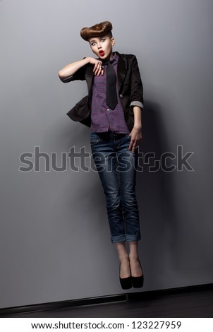 Funny Expressive female Jumping in studio - Play the Ape - stock photo