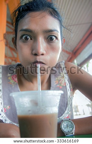 funny face girl drinks coffee - stock photo