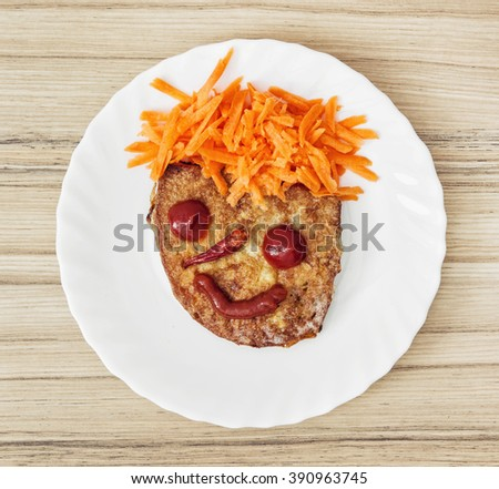 Funny face made of bread, carrot, chilli, tomatoes and ketchup. Humorous food. Little prince. - stock photo