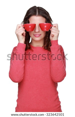 Funny face of a young girl wearing casual clothes and holding red coffee cup - stock photo