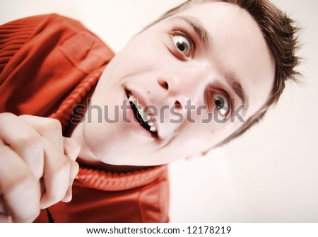 Funny face of young man at white background - stock photo