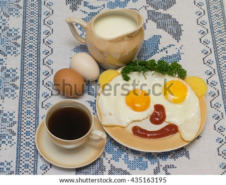 funny faces from eggs with cheese and sauce, coffee and milk - stock photo