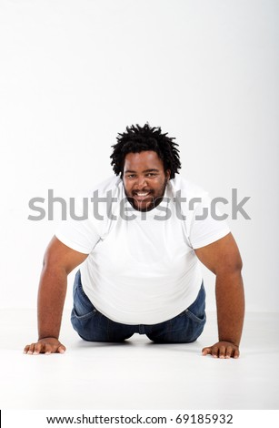 funny fat african man lying on floor - stock photo