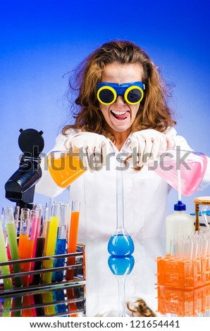 Funny female chemist in lab - stock photo